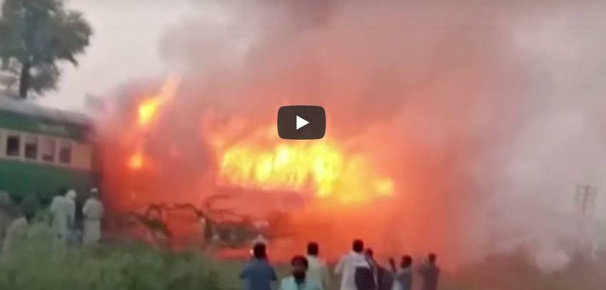 Fire on moving train killing dozens of passengers in central Pakistan