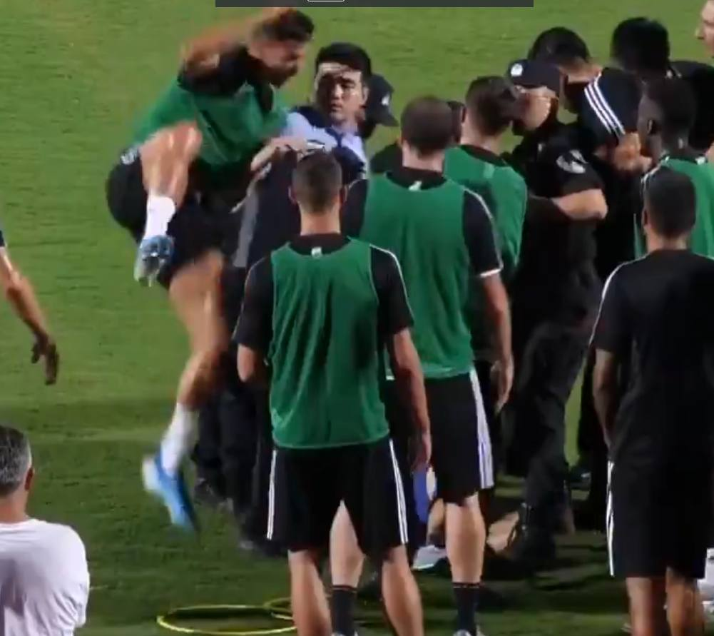 CR7 Jumps On Policeman After Fan Attempts To Invade Training Session